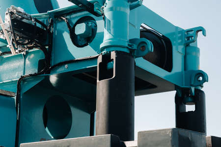 installing a counterweight on a truck crane. detail of the truck crane.Autoparts Stock Photo