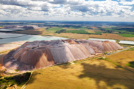 Mountains of products for the production of potash salt and artificial reservoirs. Salt mountains near the city of Soligorsk. Production of fertilizers for the Land. Belarus
