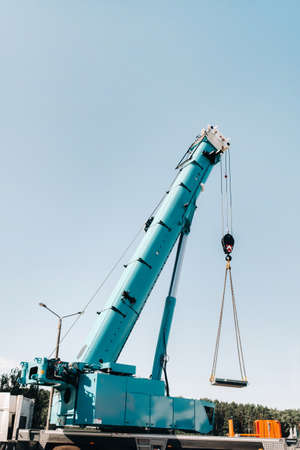 the stove is loaded onto a large blue car crane and prepared for operation. The largest truck crane for solving complex tasks