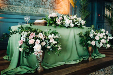 wedding table decoration with flowers on the table in the castle, table decor for dinner by candlelight.Dinner with candles.