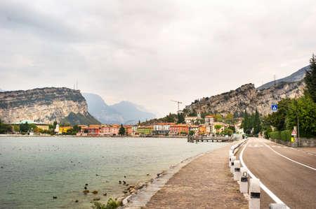 Beautiful lake Lago di Garda and the village of Torbole, Alpine scenery. Italy.