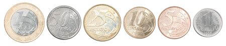 Complete set of Brazilian coins in a row isolated on white background.