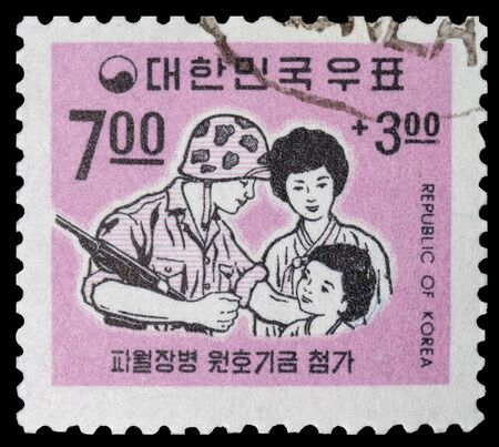 KOREA - CIRCA 1958: post stamp printed in KOREA shows Korean soldier reunited with his family, circa 1958