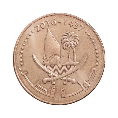 Coin ten Qatar dirhams with a picture of a sailboat isolated on white background