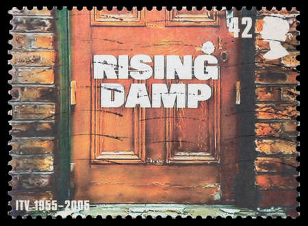UNITED KINGDOM - CIRCA 2005: A stamp printed in Great Britain dedicated to 50th Anniversary of Independent Television, shows Rising Damp, circa 2005