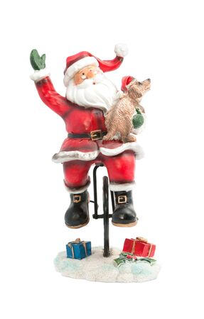 ALMATY, KAZAKHSTAN - DECEMBER 3, 2015: Statuette of Santa Claus on a bike with a dog, Happy New Year