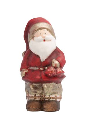 ALMATY, KAZAKHSTAN - DECEMBER 3, 2015: Small statuette of Santa Claus holding a bell