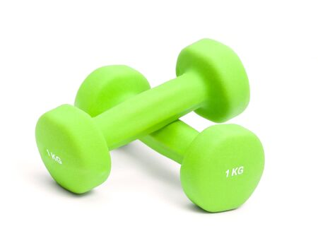 two green dumbbells isolated on white background Фото со стока