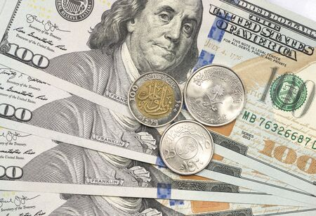Bahraini Dinar coin on top of dollar bills for financial and investment concepts Stock fotó