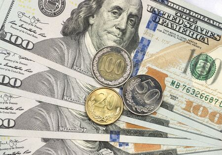 Albanian coin on top of dollar bills for financial and investment concepts