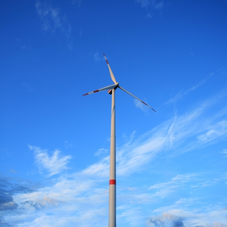 Windmill against a blue sky - renewable energy concept
