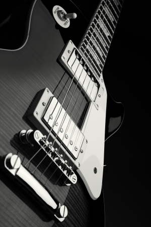 Close up shot of electric guitar - black and white