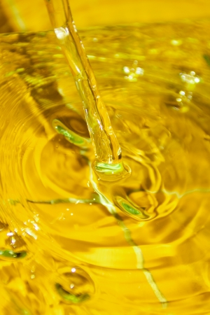 Close up shot of pouring yellow oil