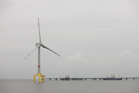 Offshore insatallation of a wind turbine or aeolian used to provide electricity by converting the kinetic energy of the wind Stock Photo
