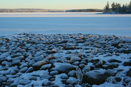 stones under the snow on the frozen lake Stock Photo - 2715926