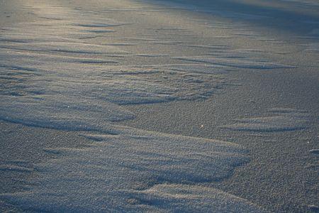 a sun lights on the snow drifts