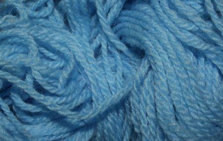a big roll of soft blue yarn