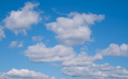 a white clouds on a blue sky Stock Photo