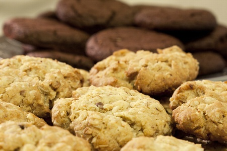 a lot of oatmeal and chocolate cookies home Stock Photo