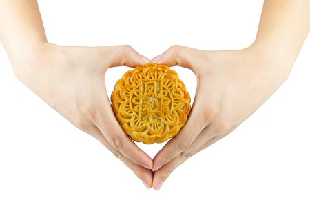 Hands holding a moon cake photo
