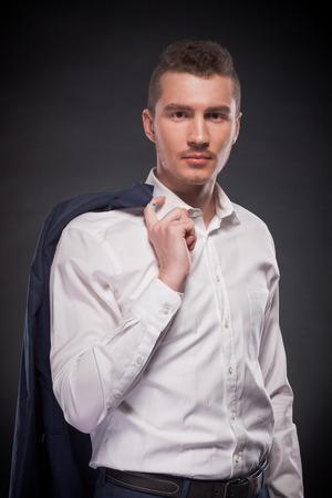 man holding jacket over his shoulder photo