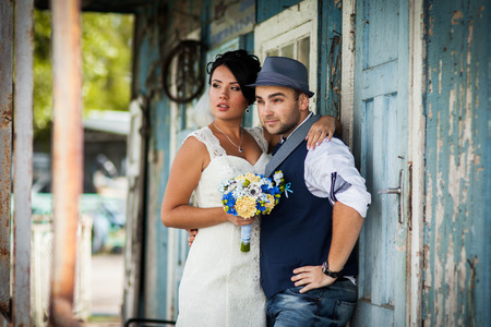 smiling man: Stylish Autumn wedding a beautiful bride and brave groom
