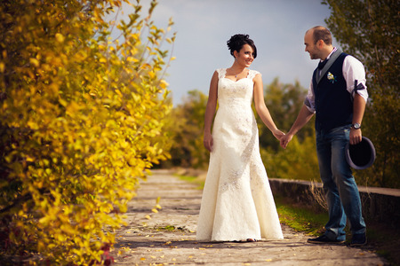 black woman white man: Stylish Autumn wedding a beautiful bride and brave groom