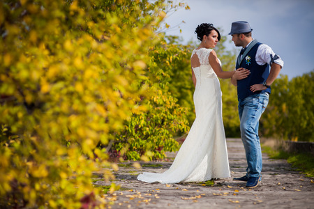 happy black woman: Stylish Autumn wedding a beautiful bride and brave groom