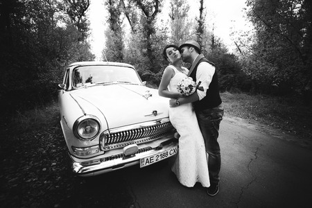 Stylish Autumn wedding a beautiful bride and brave groom photo