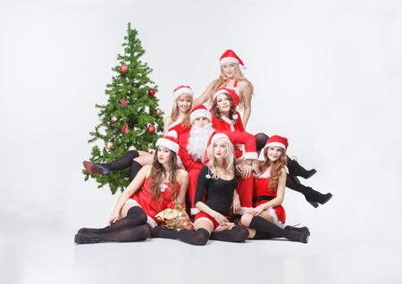 Santa and Santa's girls white isolated Stock Photo