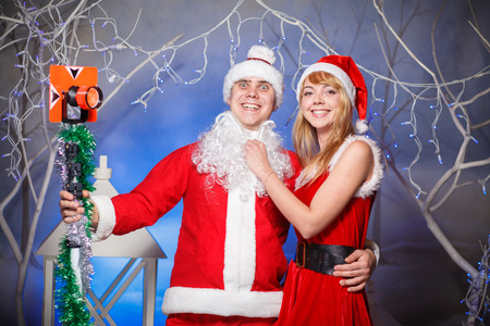sexy christmas elf: Santa Claus and Snow Maiden girl in red Stock Photo