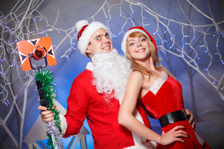 sexy elf: Santa Claus and Snow Maiden girl in red Stock Photo