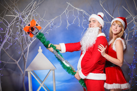Santa Claus and Snow Maiden girl in red photo