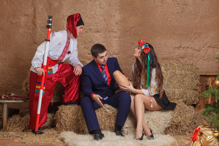 Ukrainian national clothes traditions sitting red girl photo