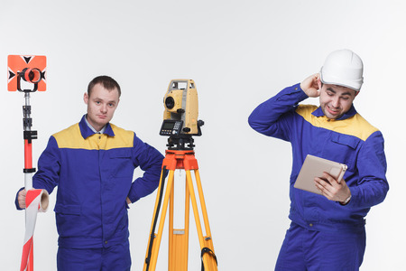 engineers on site white isolated blue theodolite photo