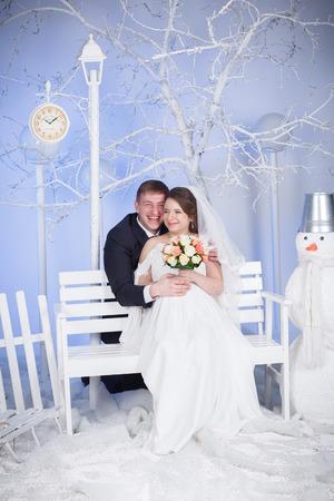 Pregnant bride and groom winter wedding studio photo