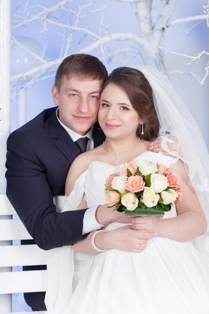 Pregnant bride and groom winter wedding studio photo