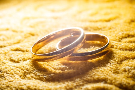 big and small: wedding rings two gold big small flash
