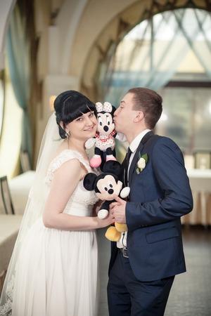 spouses: Bride groom Mickey Mouse wedding toys dress Stock Photo