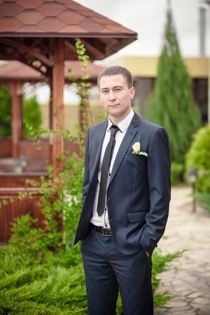 groom man in park man in suite wedding photo