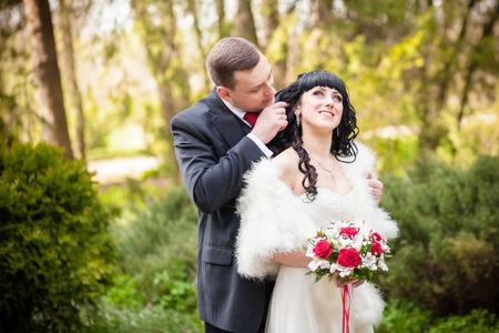 embraces: groom gently embraces the bride Kiss Park