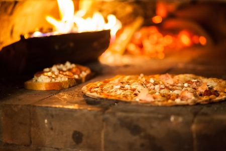 wood burning: Pizza in old stove fire temperature hot