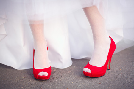 Wedding shoes red women on the green grass in style photo