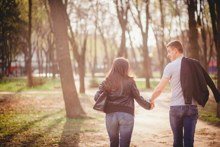 loving couple in the park spring evening photo