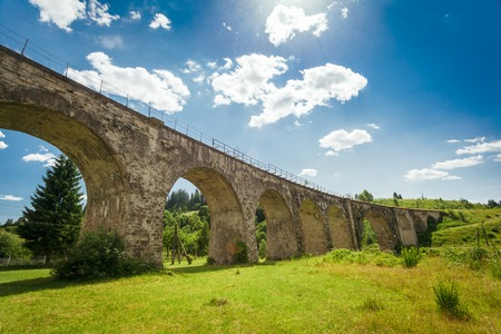 old packhorse bridge: Old stone bridge on a background of blue sky