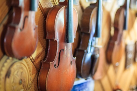 violins: some old violins in a row, pink