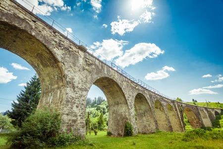 old packhorse bridge: Old stone bridge on a background of blue sky