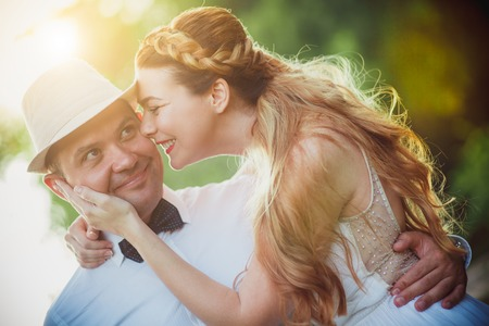 the bride groom gently embraces in summer Stock Photo