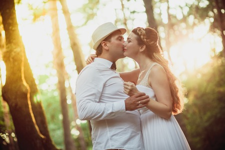wedding food: Bride and groom having fun in park
