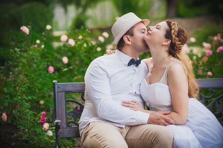 happy wedding: Bride and groom having fun in park